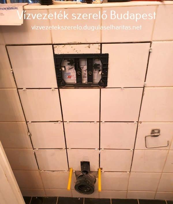 Falba épített WC. tartály burkolása