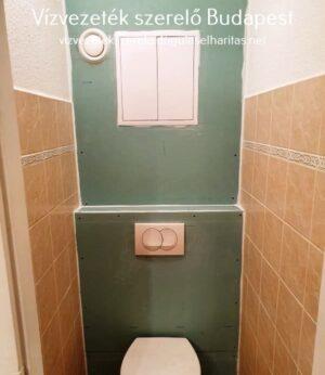 Falba épített WC. tartály burkolás után